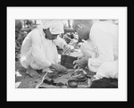 Pearl buyers examining pearls by Alan Villiers