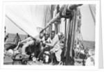 The crew labour on the mainsail after Haifun by Alan Villiers