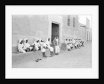 Sailors relaxing outside a merchant's house by Alan Villiers
