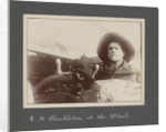 E.H.Shakleton at the wheel from National Antarctic Expedition photo album by Sir Ernest Henry Shackleton