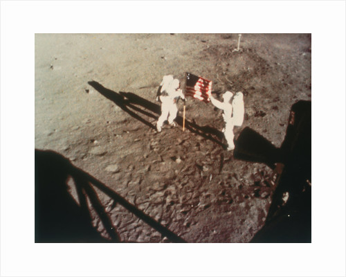 Armstrong and Aldrin unfurl the US flag on the moon, 1969 by Unknown