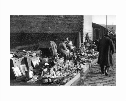 A display of goods at the flea market, Paris by Ernest Flammarion