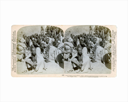 Boxer prisoners captured and brought in by the US 6th Cavalry, Tientsin, China by Underwood & Underwood