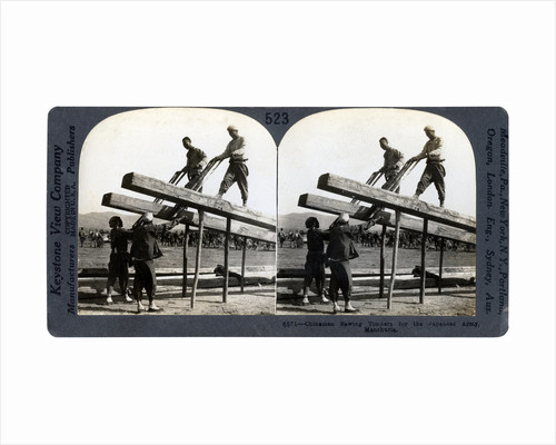 Chinese men sawing timber for the Japanese army, Manchuria, Russo-Japanese war by Keystone View Company