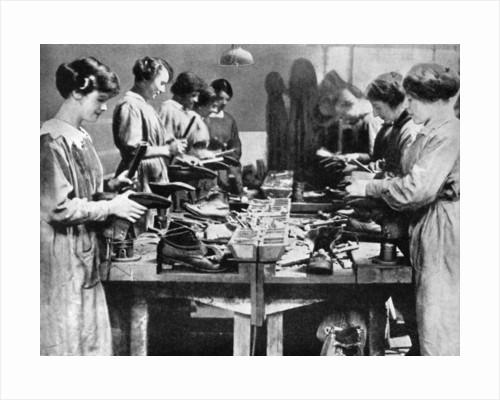Women cobblers repairing footwear for the war effort by Anonymous