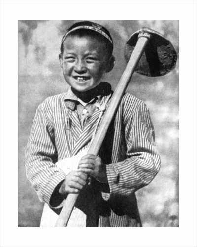 Uzbek schoolboy working on a farm by Anonymous