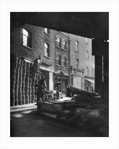 Fruit baskets piled against houses at Borough Market, London by Whiffin