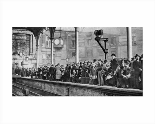 A bank holiday crowd waiting for a train to Margate, London by Anonymous