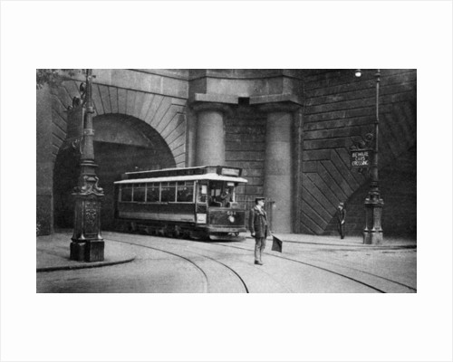 A tram running beneath Kingsway, Aldwych and Somerset House, London by Anonymous