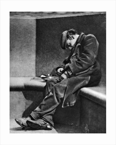 A man sleeping on Blackfriars Bridge, London by Walter Benington