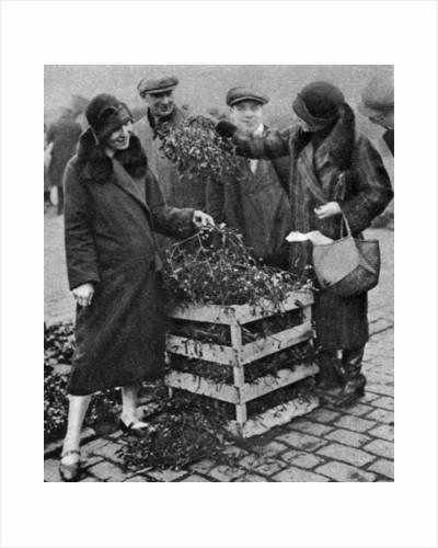 Women choosing bunches of mistletoe, Caledonian Market, London by Anonymous