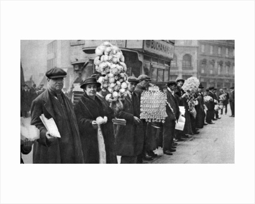 Street hawkers selling football favours in Walham Green, London by Anonymous