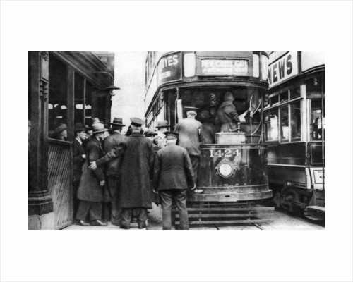 Getting on to a tram at Blackfriars, London by Anonymous