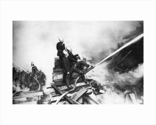 Firemen fighting a fire at a timber yard, London by Anonymous