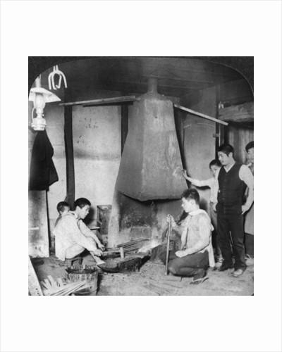 A Japanese blacksmith at his forge, Yokohama, Japan by Underwood & Underwood
