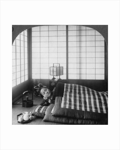 A geisha sleeping in a tea house, Hikone, Japan by Underwood & Underwood