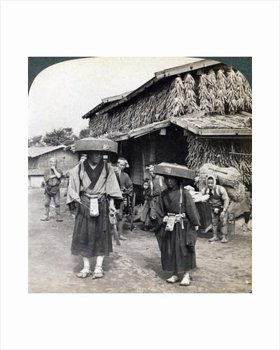 Pilgrim beggars beating little gongs, near Lake Kawaguchi, Japan by Underwood & Underwood