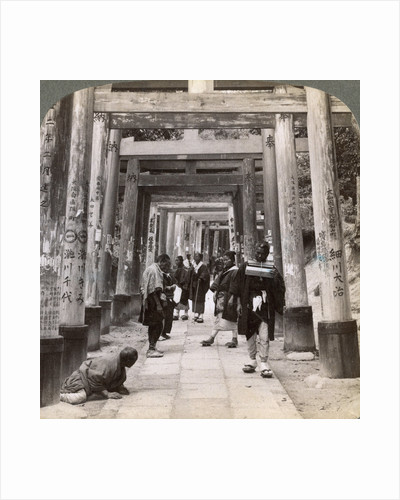 Coming and going under long rows of sacred torii, Shinto temple of Inari, Kyoto, Japan by Underwood & Underwood