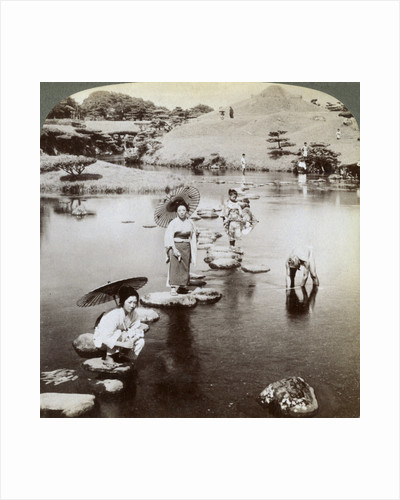 Women crossing the lake on stepping stones, Suizen-ji Garden, Kumamoto, Japan by Underwood & Underwood