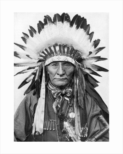 A Native American chief wearing his headdress by Anonymous