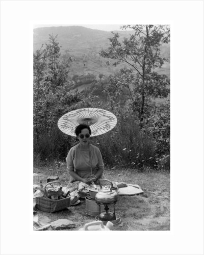 Woman under a parasol having a picnic by Anonymous