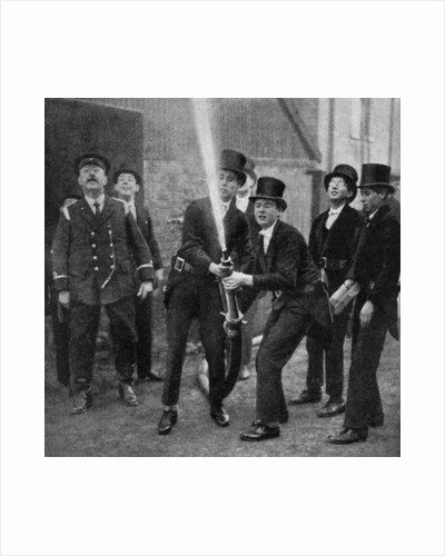Eton's amateur firemen practising a hose drill, Berkshire by Anonymous
