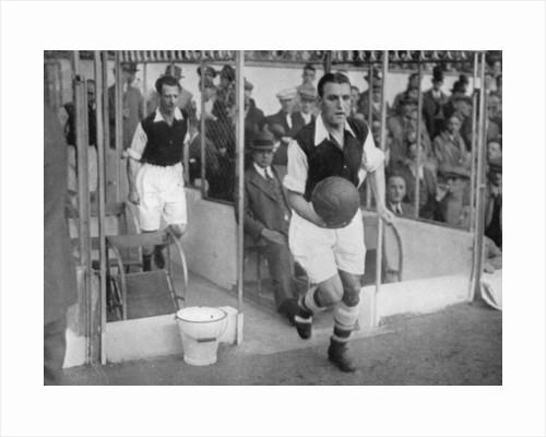 Arsenal FC captain Eddie Hapgood runs onto the pitch at Highbury, London by Barratt's Photo Press Ltd
