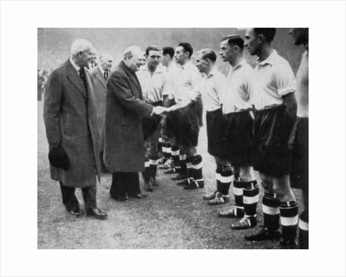 Winston Churchill greets the England football team, Wembley, London, October 1941 by London News Agency
