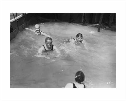 Passengers in the swimming pool on board a cruise ship by Anonymous
