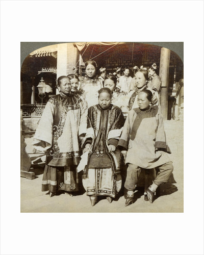 A group of women in the courtyard of a wealthy Chinese house, Peking, China by Underwood & Underwood