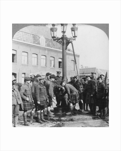 Soldiers filling their water bottles at the town pump La Gorgue, France, World War I by Realistic Travels Publishers
