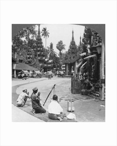 Worshipping before an idol, Shwedagon Pagoda, Rangoon, Burma by Stereo Travel Co