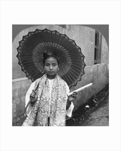 Young Burmese woman holding a huge cigar, Rangoon, Burma by Stereo Travel Co