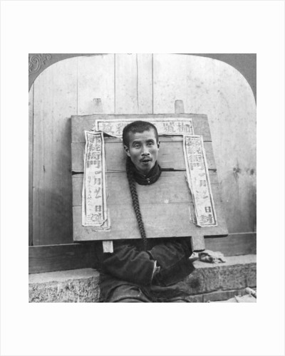 Chinese prisoner in the cangue placarded with the record of his crime by CH Graves