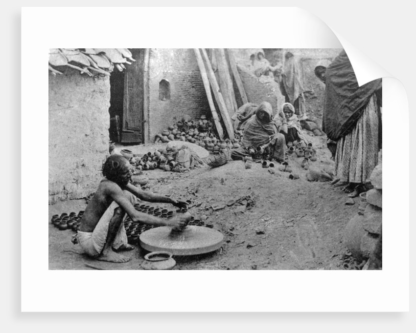 A potter at work, India by Anonymous