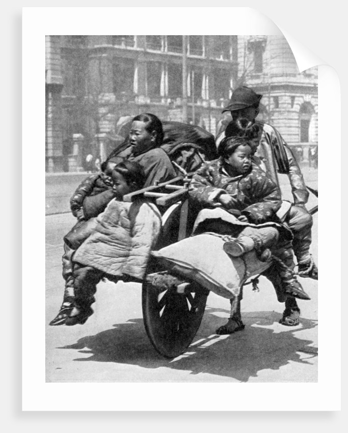 Chinese family on a cart by Sport & General