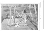 Iban woman making thread with a mangle, Borneo by Dr Charles Hose