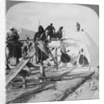Stacking salt in the great salt fields of Solinen, Black Sea, Russia by Underwood & Underwood