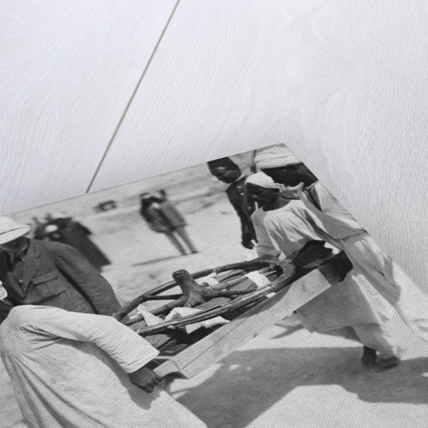 Removing a chariot wheel from the Tomb of Tutankhamun by Harry Burton