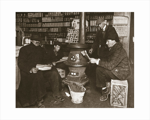 A group of men around a stove in a shop by Anonymous