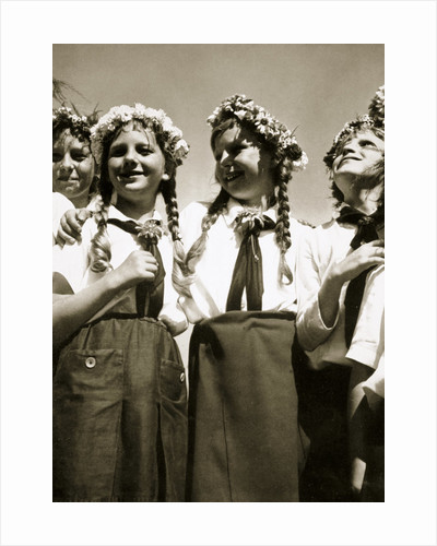 Four German girls smiling with garlands in their hair by Anonymous