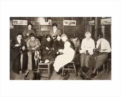 A group of women receive a lesson in boot repairing by S and G