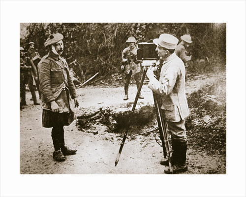Cameraman filming a wounded soldier by Anonymous