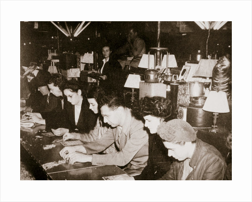 Automobile workers playing bingo at a carnival at Dearborn by Anonymous