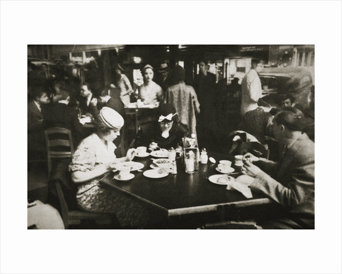 Office workers lunching in a restaurant by Anonymous