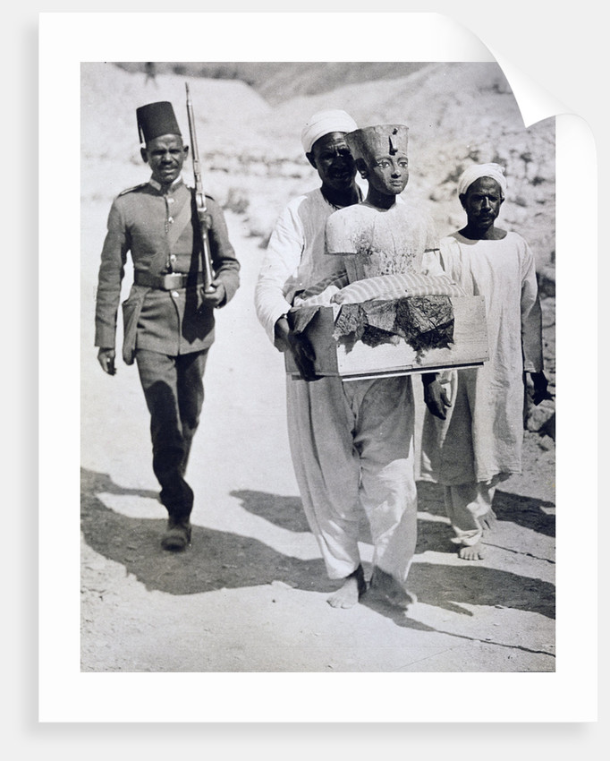 Mannequin or bust of Tutankhamun being carried from his tomb by Harry Burton