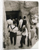 A party going down the steps to the tomb of Tutankhamun by Harry Burton