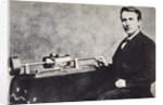 Thomas Alva Edison sitting beside his invention, the phonograph by Anonymous