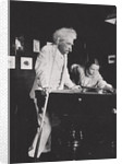 Mark Twain, American author, playing pool by Anonymous