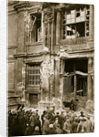 A crowd of men gathered in front of a ruined building by Anonymous